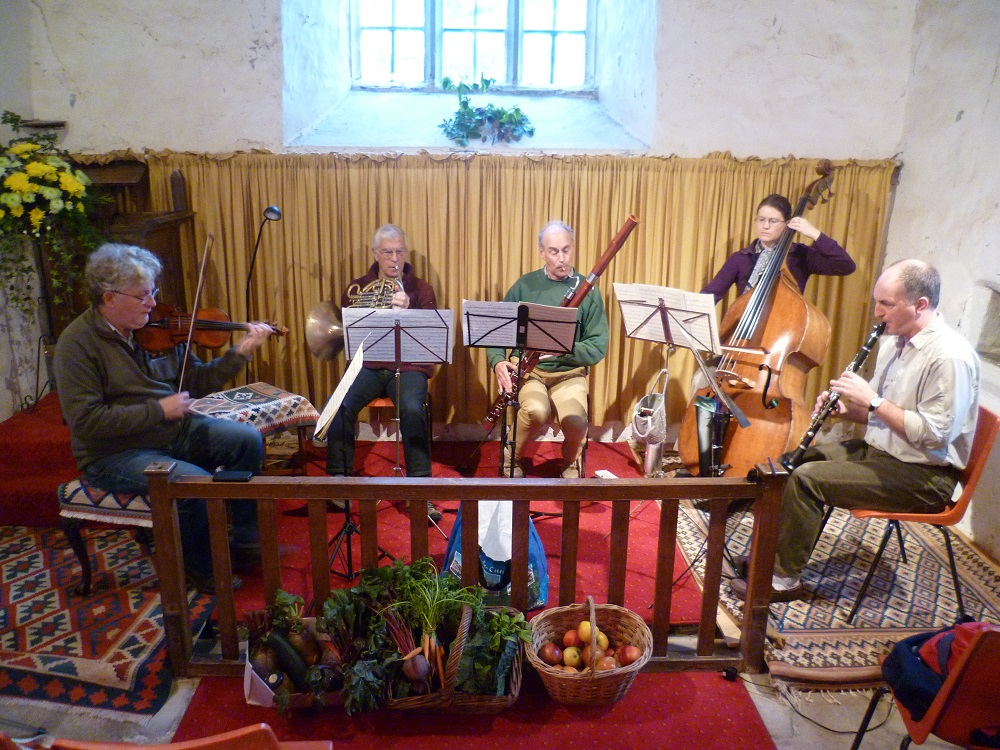 A photograph of Huw Robinson and other musicians in the Craswall Ensemble playing for Concerts for Craswall