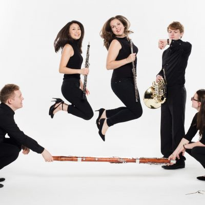 A photo of the Magnard Ensemble skipping taken by photographer Benjamin Ealovega
